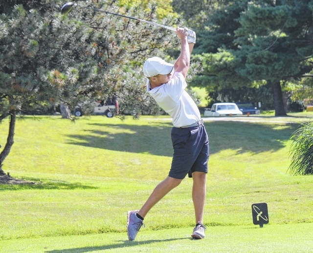 Graham's Alex Jenkins hits his tee shot off the first hole Monday against Urbana. Results from the match were not reported by press time.