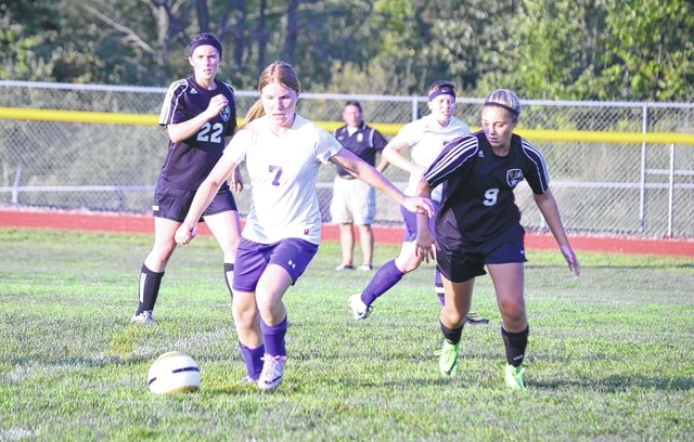 Mechanicsburg's Tori Jacobs dribbles past a Benjamin Logan defender in midfield Thursday. Jacobs scored the Indians' lone goal in the contest.