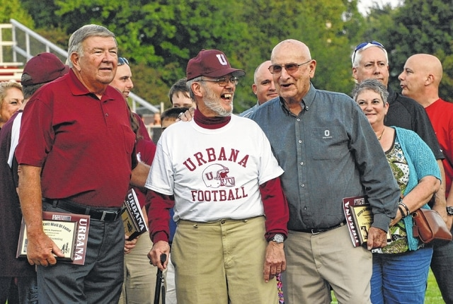 (From left to right): Bob Brenning, Mike Simpson and Ray DeCola gather together after each was awarded a plaque inducting him into the George Scott Ring of Honor during last Friday night's pre-game ceremony at the London/Urbana football game at UHS. Brenning and DeCola are former Hillclimber coaches while Simpson was the school's long-time athletic trainer.