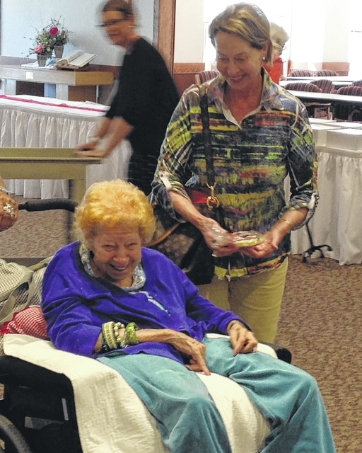 "Jean Kerns, left, and her daughter Linda Hilliker share a laugh during the ""mega"" bake sale at Green Hills Community Sept. 16. Kerns has been a resident of Green Hills for a decade and says she hasn't regretted a minute of it. ""I'd never get out if I didn't live here,"" she said. ""I've always got something going on."""