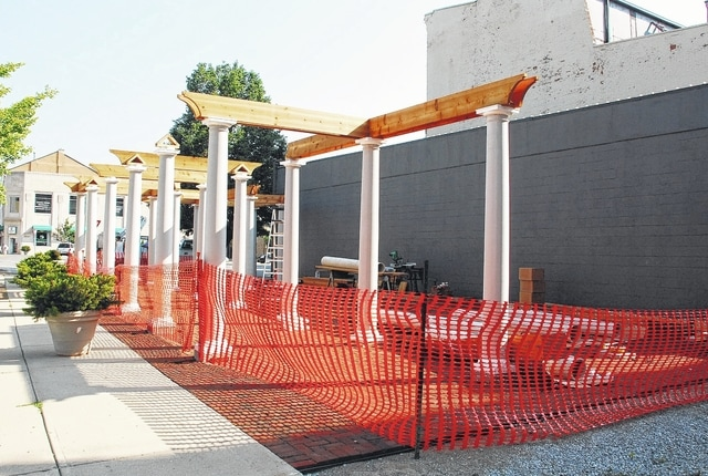 Located in the southeast corner of Monument Square in downtown Urbana, Legacy Park is starting to take shape as workers are in the process of installing a pergola.