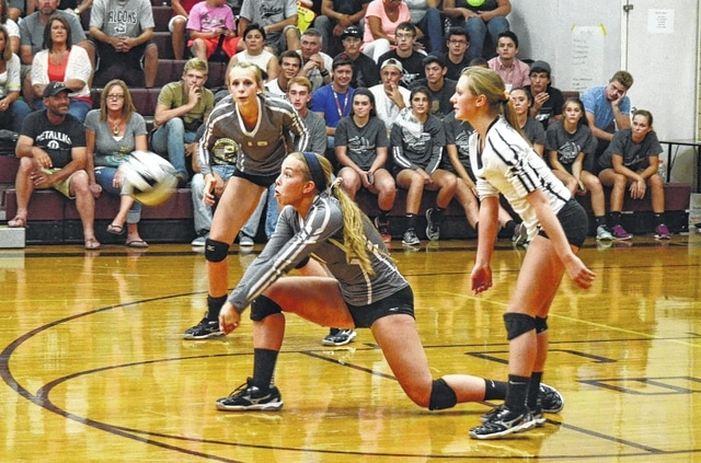 Graham's Lisa DeWeese digs a serve out against Urbana Tuesday night.