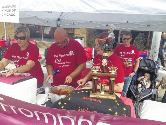 Abe Froman's Sausage Kings of Chicago had to hand out samples of their prize-winning chili while taking care of last year's first- place trophy. Next year, Froman's will have yet another trophy to display, as it again won the Judges' Award for best chili this past Saturday.