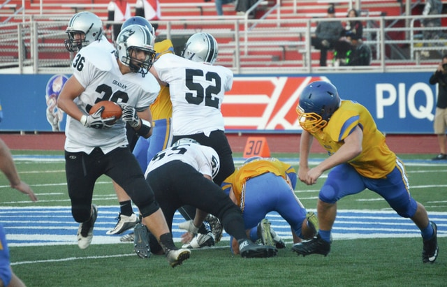 Graham's Stephen Dunham pounds the ball into the Lehman defense Saturday night.