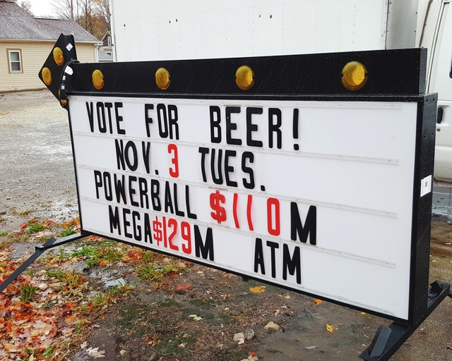 Pictured is one of the signs in the village of Christiansburg asking voters to vote for beer Tuesday. The Christiansburg General Store is trying to pass a local option that would allow for beer to be sold at that store.