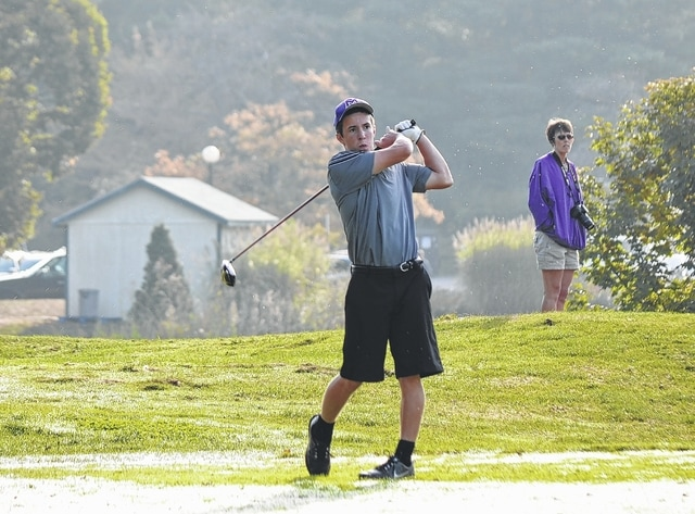 Mechanicsburg's Corey Bogan (pictured) tees off in the dew Thursday morning at Weatherwax Golf Course. Bogan shot a career-best 85 and provided the Indians with enough push to win the district championship.