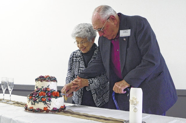 Dorothy and Russell Carney of St. Paris perform a celebratory cake-cutting at the <em>Urbana Daily Citizen</em>'s 35th annual Golden Anniversary Celebration on Sunday. The Carneys celebrated 60 years of marriage in April. The newspaper hosts the event for local couples married at least 50 years. About 50 couples attended festivities Sunday at the county fairgrounds. Music, cake, ice cream and surprises were on the agenda. This year's sponsors include Green Hills Community, Peoples Savings Bank, Walter and Stowe Funeral Home and Vancrest of Urbana.