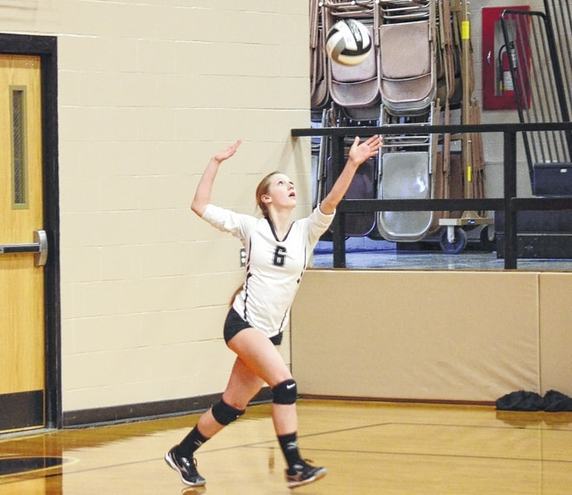 Graham's Lauryn Holcomb serves during the first set against Kenton Ridge Monday.