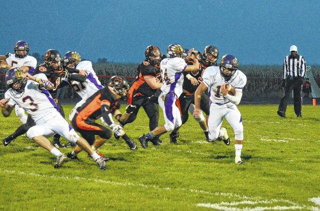 Mechanicsburg's Kaleb Romero runs the ball to the left against West Liberty-Salem Friday.