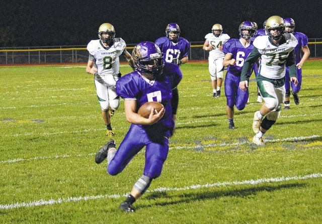 Mechanicsburg's Wade Smiddy turns upfield after catching a pass near the sideline Friday against Catholic Central.