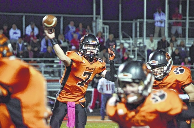 West Liberty-Salem's Brandon Upton throws a screen pass against Southeastern Friday. Upton tallied 148 yards passing on the night.