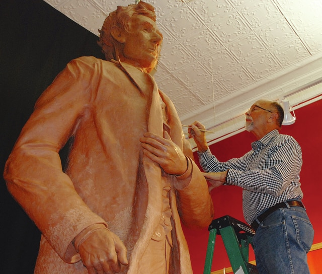 Urbana artist Mike Major works on an 11-foot Abraham Lincoln sculpture in his downtown studio.