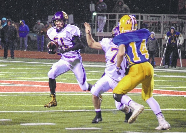 Mechanicsburg's Phil Cook bounces to the outside against Marion Local Saturday night. Cook was contained most of the night and held to just 30 yards on the ground.