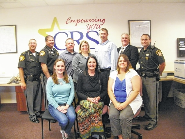 The CRSI Management Team includes, seated from left, Bonnie Pohlschneider, Audra Bean, Jennifer Baldwin, back from left, Capt. Dave Rapp, Sheriff Matthew R. Melvin, President Scott DeLong, Cindy Cantrell, Jarred Vordemark, Eagles President Tim Kemper and Sgt. Jason Byers.