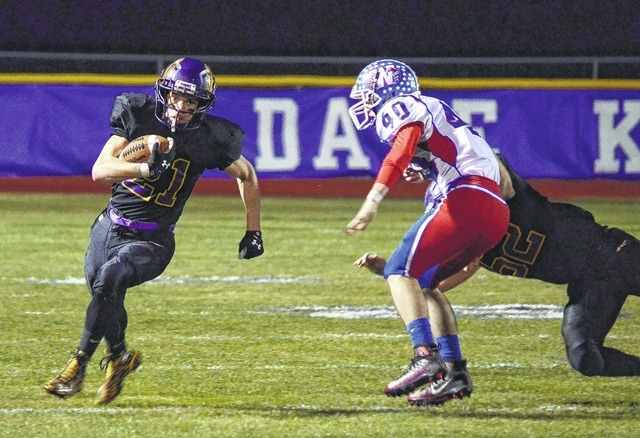 Mechanicsburg's Phil Cook bounces a run to the outside and scores on an 80-yard touchdown scamper in the first quarter against Williamsburg Saturday night.