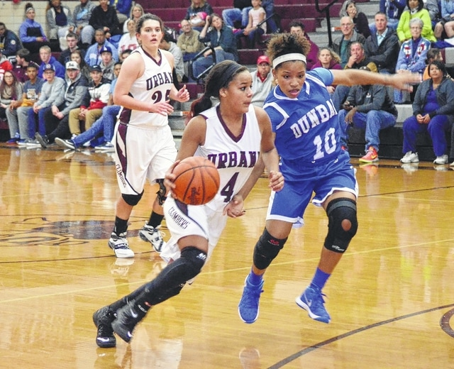 Urbana's Hunter Rogan drives past her defender on the way to the basket Friday night against Dunbar. Urbana won its first-round game and will play Jonathan Alder for the championship at 2:30 p.m. Saturday.