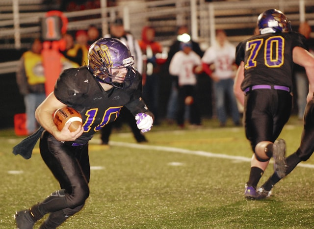Mechanicsburg quarterback Kaleb Romero looks for running room during last Saturday night's playoff game at Sidney. The second-seeded Indians (12-0) play top-seeded Marion Local (11-1) today at 7 p.m. at Bellefontaine in the Division VI, Region 22 final.