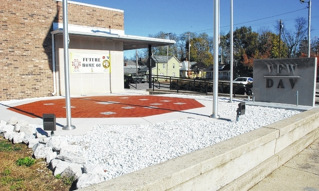 "Pictured is the ""Patio of Flags"" located in front of the Joint Headquarters of DAV Chapter 31 and VFW Post 5451 at 220 E. Court St. in Urbana. Ten memorial stones engraved with the names of the 10 Champaign County residents killed in the Vietnam War will be unveiled near the flags during a ceremony on Veterans Day."
