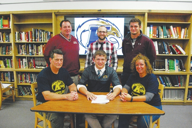 Urbana High School senior Jack Harris recently signed a letter of intent to wrestle at Kent State. Pictured are (seated left to right) - Dan Harris (Dad), Jack Harris, Debbie Harris (Mom). Standing - Ryan Pine (Head Coach), Chad Lensman (Former Assistant Coach), Sam Harris (Assistant Coach/brother).