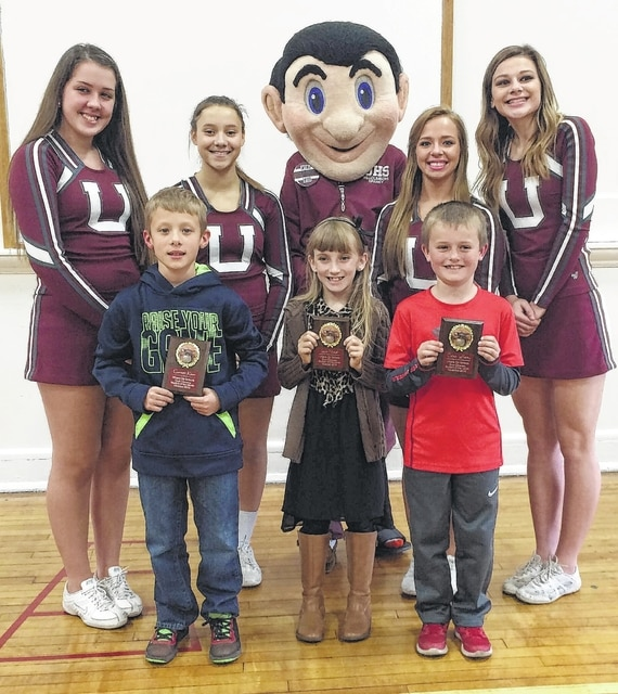 South Elementary Students of the Month are, front from left, Garret Kiser (3rd grade), Layla Nickell (3rd grade) and Colton Lafferty (3rd grade). They are pictured with, back from left, Morgan Bandy, Mari Artis, Kaylan Turnmire (as Sparky), Val Batova and Kaelyn Bertsch.