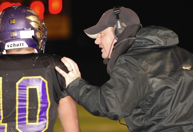 Mechanicsburg Coach Kurt Forrest (right) talks with quarterback Kaleb Romero during last Saturday night's playoff game at Sidney.