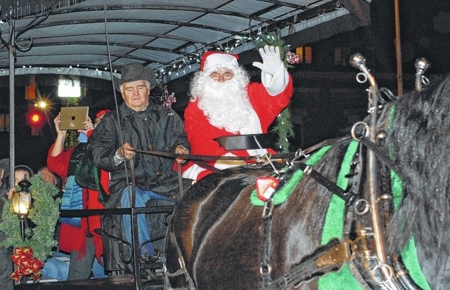 Horse-drawn trolley driver Bob Skelton had the honors of bringing Santa into the throng of children awaiting his arrival at the Gloria Theater in Urbana on Friday. A Christmas parade of horses opened the evening before Santa made his big entrance downtown. Santa Land at the Gloria will be open through Dec. 19 on Fridays from 5 to 8 p.m. and Saturdays from 11 a.m. to 2 p.m. During the hours of operation, children are invited to hand-deliver their letters to Santa, and parents are invited to take pictures of their children with Santa.