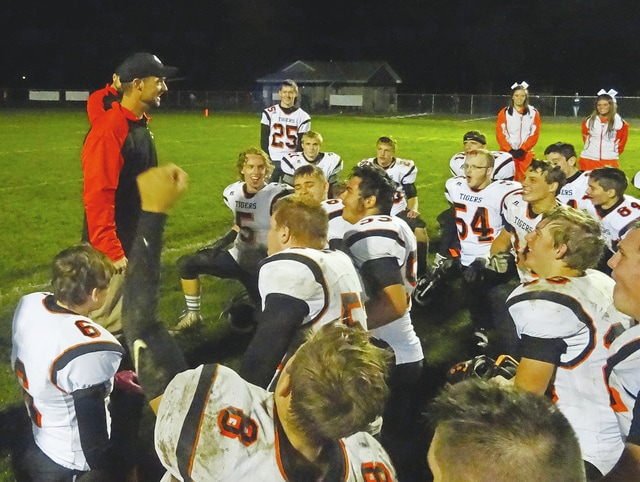 WL-S players gather around Coach Dan McGill after Saturday night's win at Cincinnati Country Day.