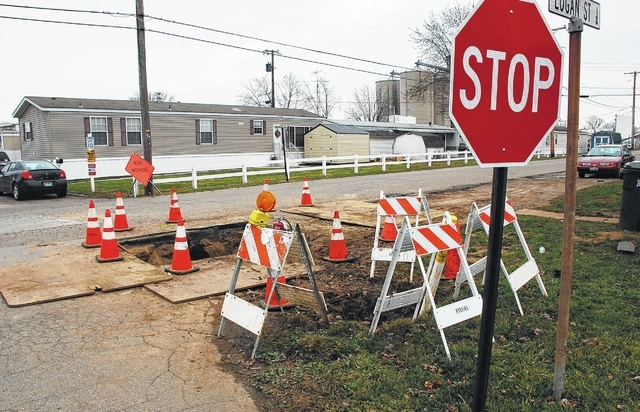 Construction crews spent last week working on gas lines in the vicinity of Logan Street in Urbana as part of Columbia Gas's Harmon Avenue Area Natural Gas Pipeline Replacement Project. Due to the holidays, work on the project has been halted until Jan. 4, at which time crews will begin installing service lines. Pictured is a construction area at the corner of Logan Street and Evans Avenue.