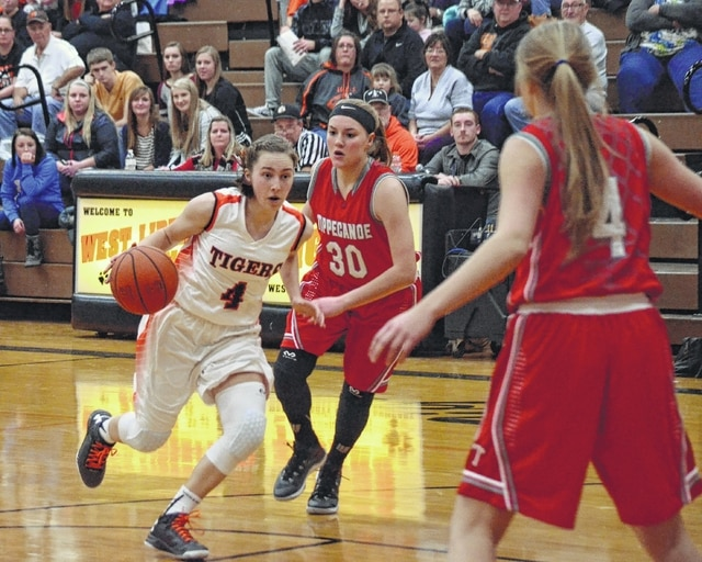 West Liberty-Salem's Gabby Hollar (4) drives into the lane versus Tippecanoe on Monday at West Liberty-Salem.