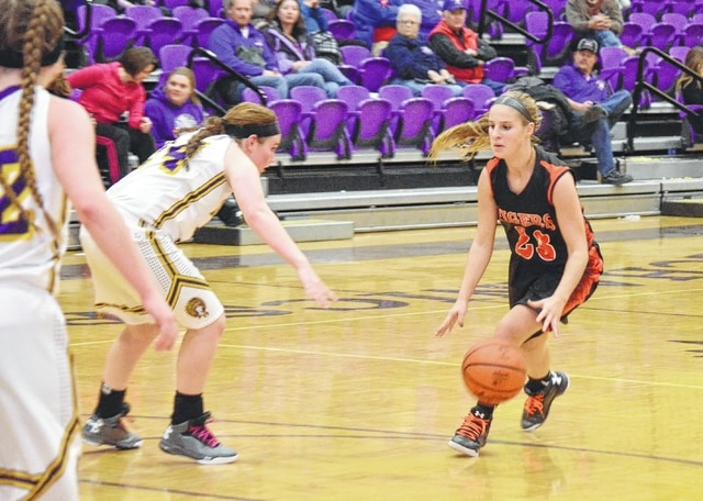 West Liberty-Salem's Taylor Lauck (right) works to get past Meagan Hux at Mechanicsburg on Thursday.