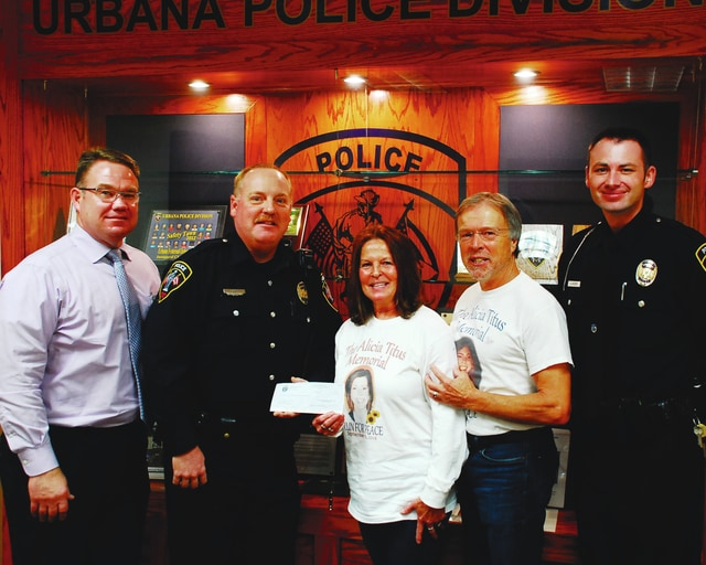 The Urbana Police Division received a donation from the Alicia Titus Memorial Fund Thursday to help benefit the Safety Town program. Pictured from left to right are Urbana Police Lt. Seth King, Officer Todd Pratt, Bev Titus, John Titus and Officer Jason Kizer.