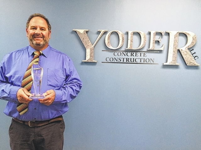 Jeff Yoder, who co-owns Yoder Concrete Construction LLC in West Liberty with his wife, Roberta Yoder, poses with the Torch Award for Ethics, awarded in October by the Better Business Bureau serving central Ohio.
