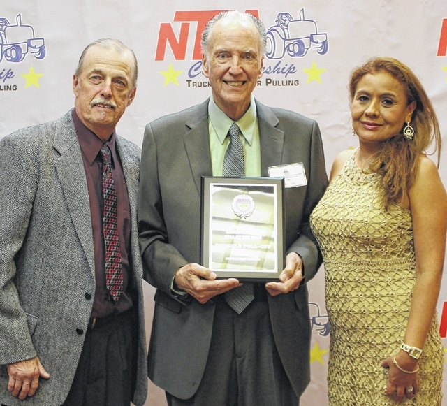 From left, Mike Keena, Enderle Fuel Injection president, founder Kent Enderle and Yovana Keena accept the 2015 Grand National Pull of the Year Award at the NTPA's Awards Banquet.