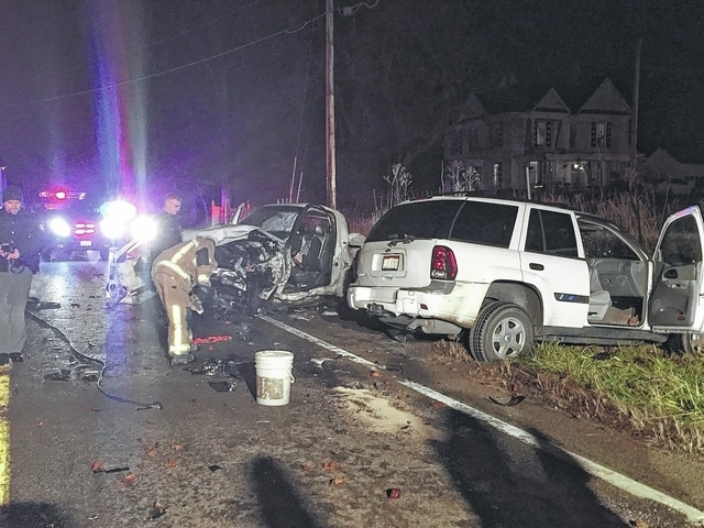 First responders are shown working at the scene of a two-vehicle injury crash on Tuesday in Goshen Township.