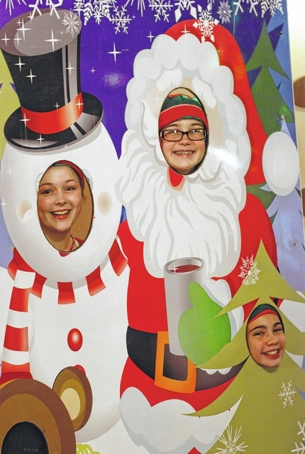 A trio of helpful elves pose in the winter wonderland facade in the lobby at the Gloria Theater in Urbana. Katie Trudo is on the left, Claire Shelpman is on the right and Marah Donahue is in the lower right opening. Santa Land at the Gloria will be open through Dec. 19 on Fridays from 5 to 8 p.m. and Saturdays from 11 a.m. to 2 p.m. During the hours of operation, children are invited to hand-deliver their letters to Santa, and parents are invited to take pictures of their children with Santa.