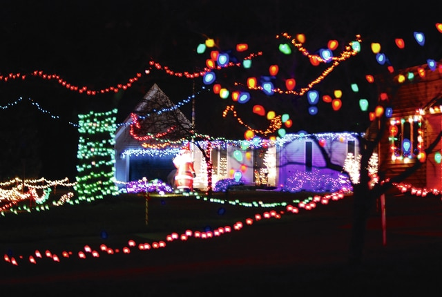 The tradition continues this winter as residents of Fountain Circle in Urbana adorn their homes with a collection of coordinated Christmas lights. Fountain Circle is located off Boyce Street on Urbana's north side near Melvin Miller Park.
