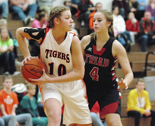 WL-S's Jamie Peterson (10) looks to pass against Triad's Audrey Lightle during Thursday's game at WL-S.