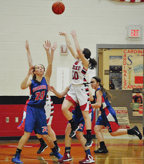 Triad's Alea Ferguson goes up for two points in the Cardinals' 43-35 win over visiting Riverside in non-league action Monday night.