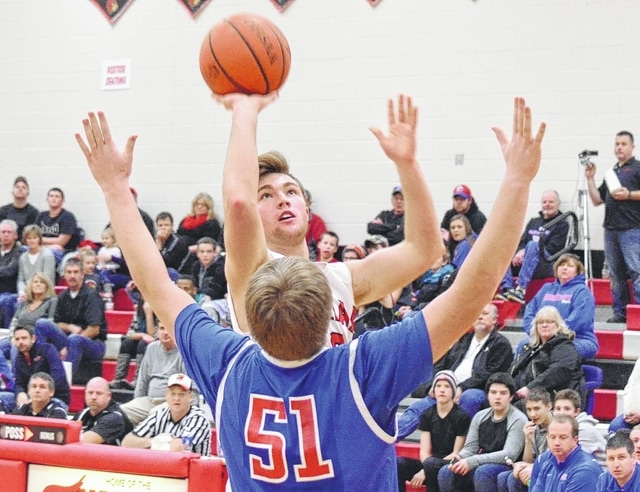 Triad's Ryan Boyd shoots a floater over Greeneview's Ethan Bradds during Friday's game.