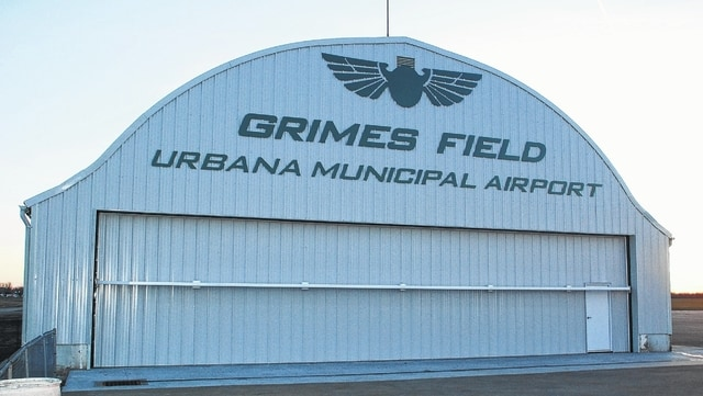 Pictured is the newly renovated north end of Grimes Hangar at Grimes Field. Both the north and south ends of the hangar were part of a roughly $90,000 project that replaced the sliding hangar doors with hydraulic ones, fixed the aprons leading to the doors, replaced both headers above the doors and installed a catch basin on the northwest corner of the hangar. During the project, crews replaced the lettering on the north end of Grimes Hangar.