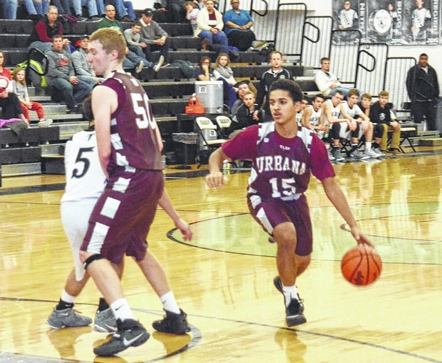 Urbana's Jace Underwood (15) uses the screen set by Levi Boettcher to free up some space Thursday at Graham.