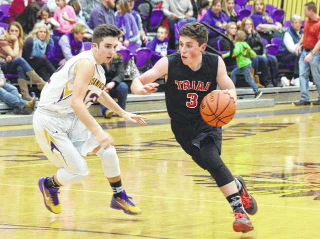 Triad's Hadley LeVan drives into the lane Friday against Mechanicsburg. LeVan finished with 8 points to help the Cardinals to a 59-40 victory.