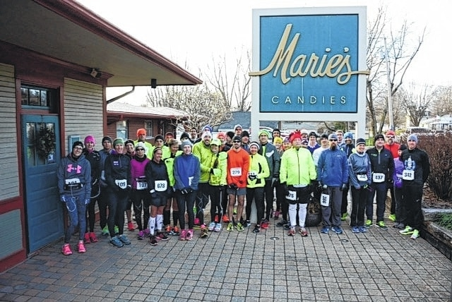 Participants await the start of the sixth annual Liberty Half Marathon at Marie's Candies in West Liberty.