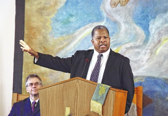 Rev. Michael Menefield addresses the congregation celebrating Rev. Martin Luther King, Jr.'s birthday on Sunday at St. Paul African Methodist Episcopal Church in Urbana.