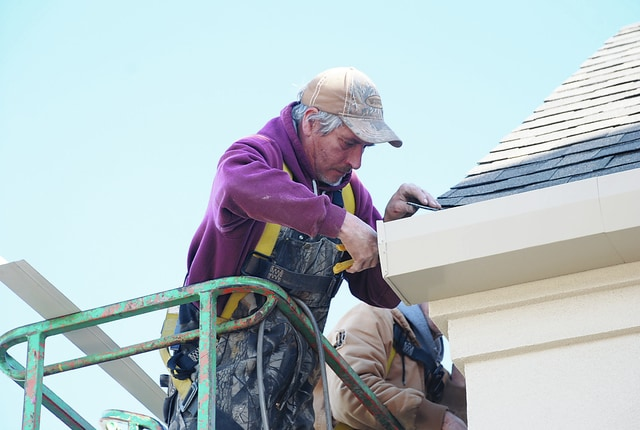 Jeff Tackett works on the roof of an addition being constructed at First Baptist Church, 401 N. Main St. It's been a mild week for people working outside on local projects. Colder weather is expected to return Sunday and Monday. According to the church website, work on the exterior of the building started last week and should be complete by the end of this week. The curb on Main Street was formed and is ready for concrete to be poured. Inside, the opening was cut for the new entrance to the sanctuary and a steel header beam installed. The two spaces are officially connected. Preparations are being made for the new stairs to be installed in the stairwell. The elevator shaft is being prepped for the elevator company to come in to work in a few weeks. Drywall work continues in the lobby and mezzanine. Kapp Construction is part of the project.