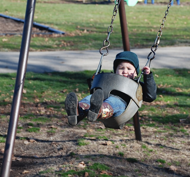 Two-year-old Quinlan Wu spends a sunny afternoon swinging at the Melvin Miller Park playground on Thursday. Wu and his mother Nicole Wu took advantage of the warmer-than-normal January temperatures. It was 45 degrees on Thursday.