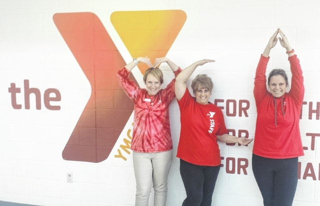 Champaign Family YMCA staff members Karen Keller, Kim Wooton and Jennifer Post are dressed in red to promote the YMCA's hosting of 'Go Red for Women' from 5 to 8 p.m. on Saturday, Feb. 27.