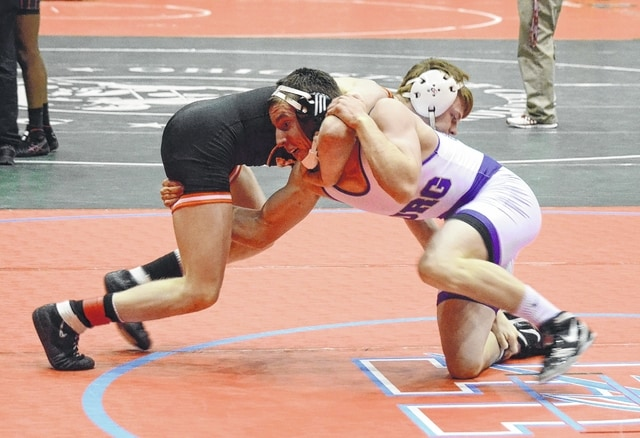 Mechanicsburg's Corey Bogan grapples with Amanda-Clearcreek's Austin Shannon in the 152-pound weight class of the Division III team duals quarterfinals at St. John Arena in Columbus on Sunday.