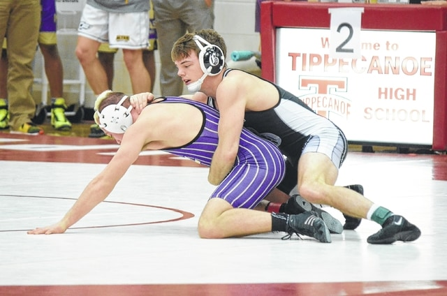 Graham's Brent Moore dispatches his opponent at 138 pounds at the sectional meet at Tippecanoe last week. Moore won the title in his class.
