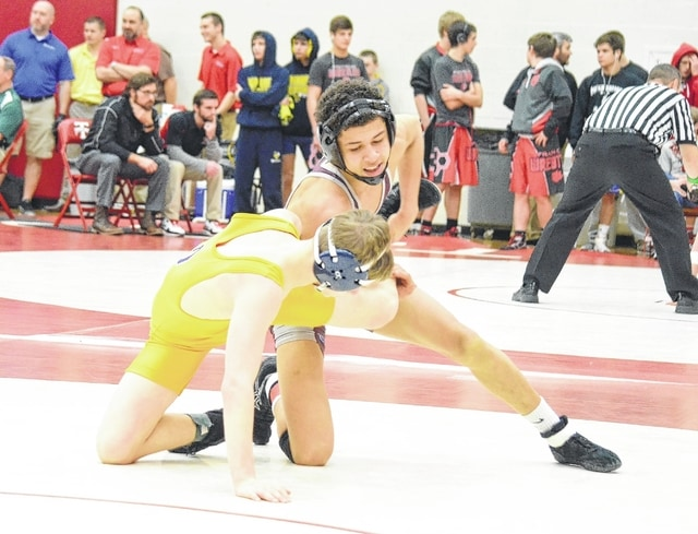 Urbana's Jaylin Cameron controls Oakwood's Nick Bowman on Saturday at the Division II sectional tournament at Tipp City. Cameron prevailed easily in the 120-pound semifinal match and was crowned champion in the weight class later in the evening.